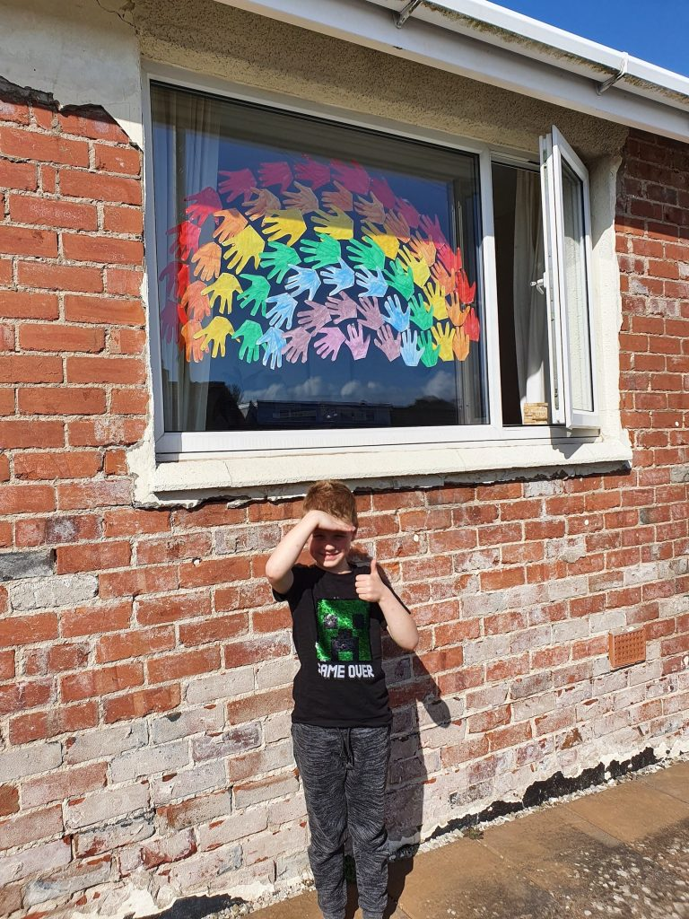 Oliver's Rainbow made from handprints.